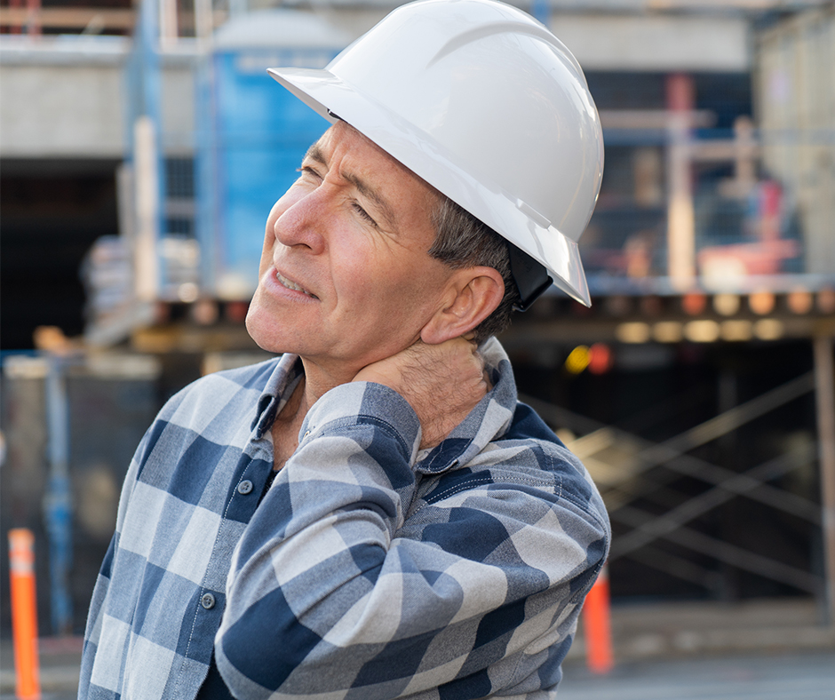 Construction worker suffering from neck pain